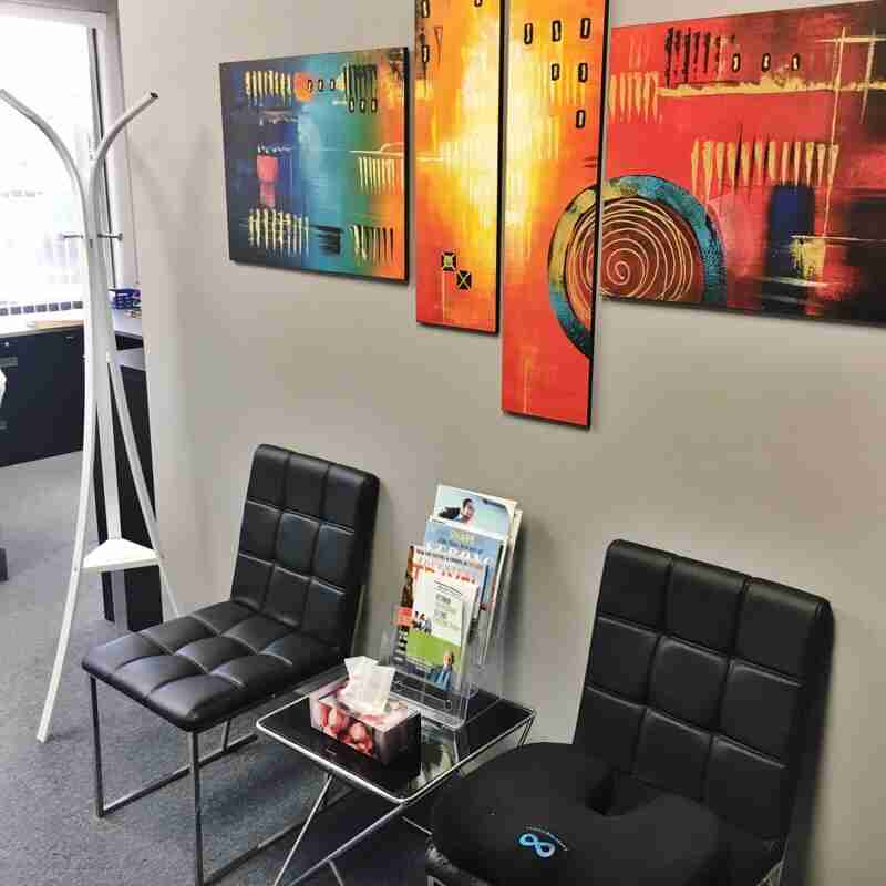 Chiropractic clinic patient waiting area near reception- Mobility Plus Chiropractic